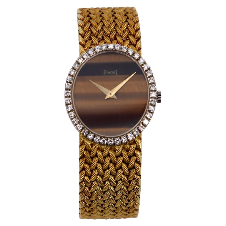 Yellow Gold Piaget Watch with Diamond Bezel and Oval Tiger's Eye Dial For Sale