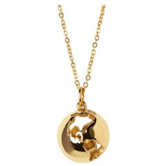 Yellow Gold Plated World Globe Necklace by Cristina Ramella