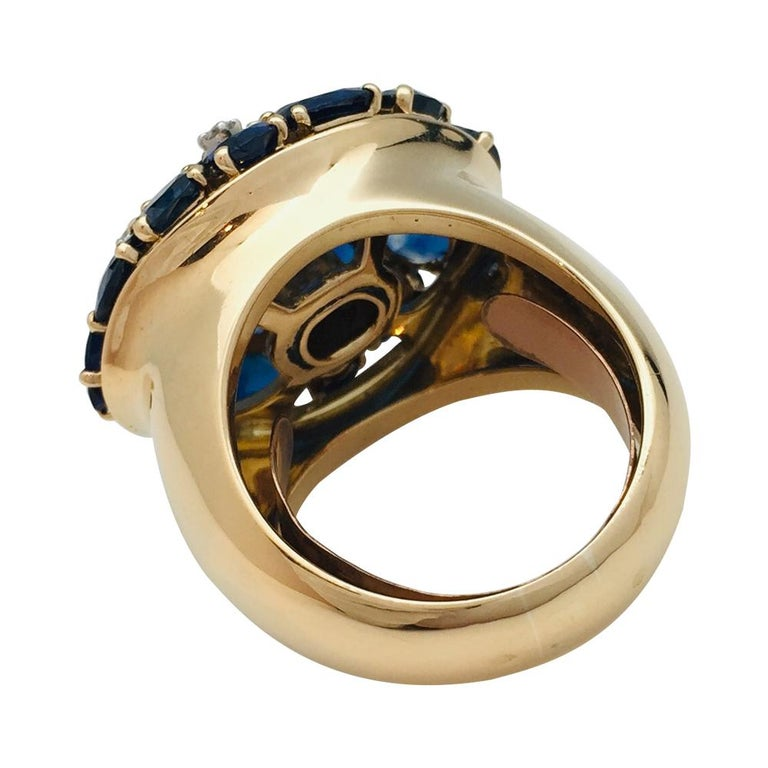 A 750/000 yellow gold important ring, paved with ovale sapphires, enhanced with single cut diamonds.  Sapphires weight: about 11 carats. Size 9 - Spring sizing ring.