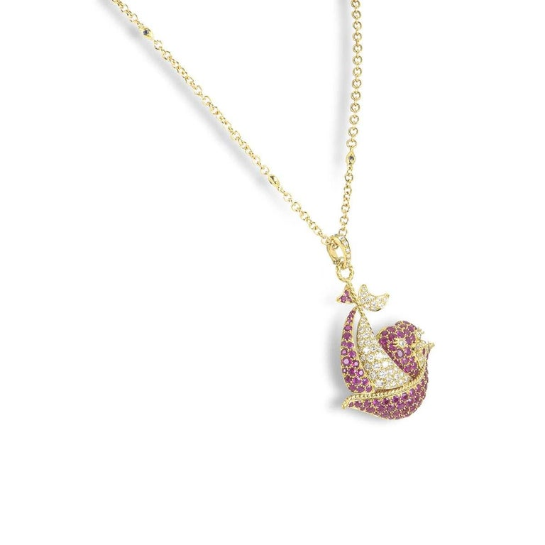 An 18k yellow gold ruby and diamond pendant. The pendant features a large sailing boat motif, set with round brilliant cut diamonds and rubies. The diamonds have a total weight of approximately 1.63ct and the rubies total approximately 4.69ct. The