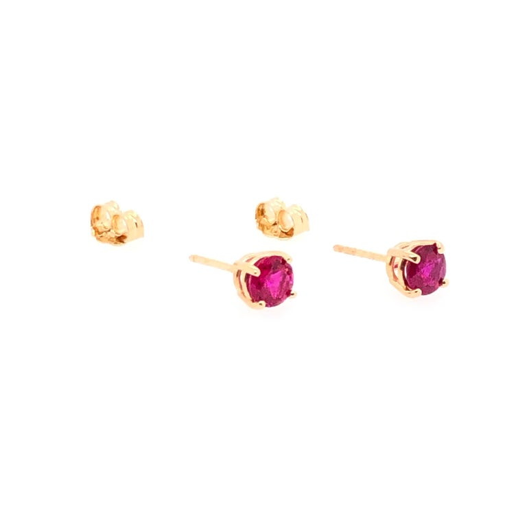 A touch of color in a timeless setting, these beautiful bright rubies illuminate the shadows. Rubies are thought to balance the heart, invigorate the body, encourage joy and laughter, and inspire courage. The classic design is steadfast enhancing