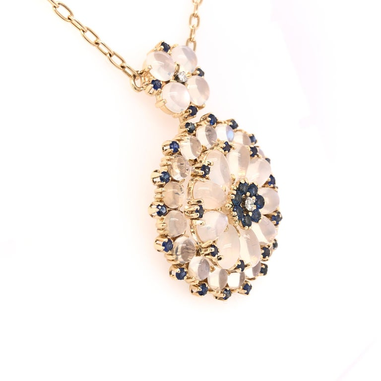 A touch of time long past, this pendant necklace brings its beauty and elegance. The large pendant can be removed from the necklace for more casual occasions.   14K Yellow Gold Sapphire Moonstone and Diamond Pendant.  Part of our Estate