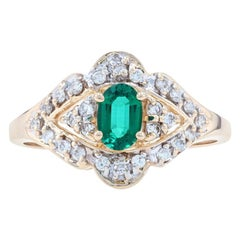 Yellow Gold Synthetic Emerald & Diamond Halo Ring, 14k Oval Cut .79ctw
