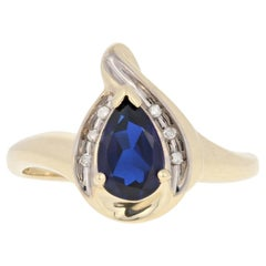 Yellow Gold Synthetic Sapphire & Diamond Ring, 10k Pear Cut .87ctw Bypass