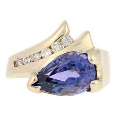 Yellow Gold Tanzanite and Diamond Ring, 14 Karat Pear 3.11 Carat Bypass