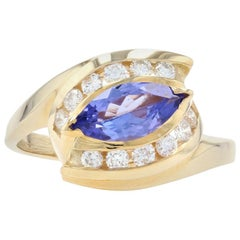Yellow Gold Tanzanite & Diamond Bypass Ring, 14k Marquise Brilliant Cut 1.30ctw