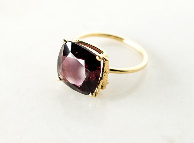 This contemporary ring is in 14 karat yellow gold with red unheated natural cushion spinel from Burma, 5.38 carats, GIL certified. It belongs to Tea collection, which was featured in Vogue UA. The size of the ring is 16.  The ring is easy to wear,