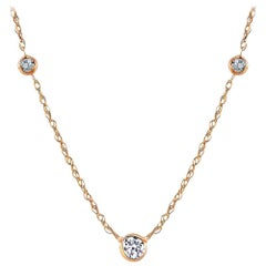 Yellow Gold Three Bezel-Set Diamond Pendant Necklace Weighing 0.30 Carat