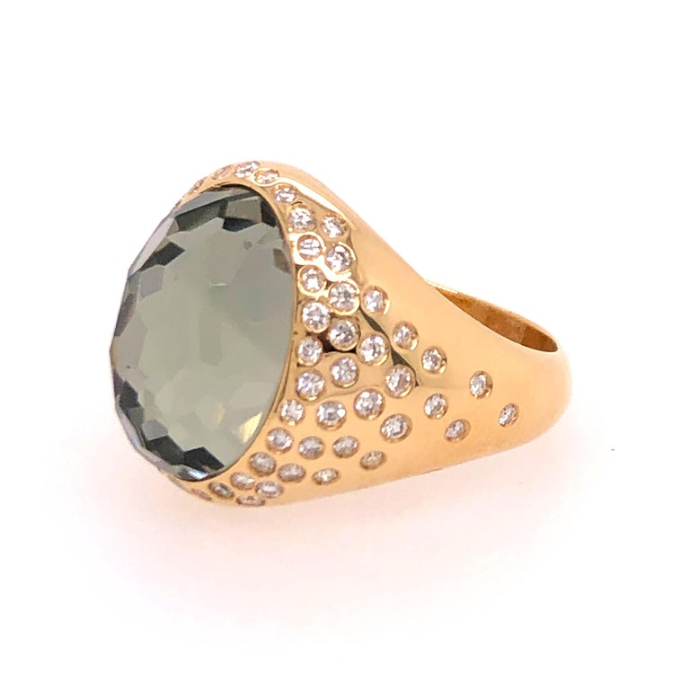 Straight from the house of Vaid Roma this wonderful asymmetrically designed topaz and diamond ring is like wearing candy. The faceted topaz and diamonds catch the light making the ring sparkle.   Total Diamond Carat Weight: 0.36 CTW  Size: 7 centered