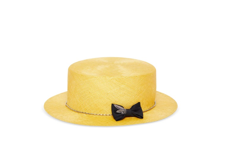 Yellow hat NWOT totally made in italy  FABRIC COLOR: Yellow    DECORATION: Metal spiral/feather veil