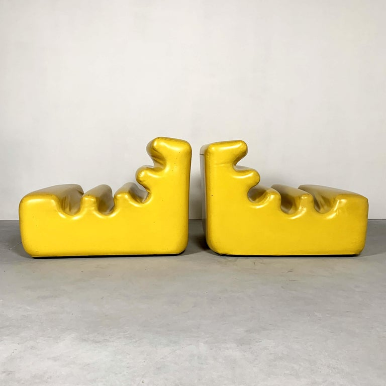 Set of two yellow vinyl lounge chairs.