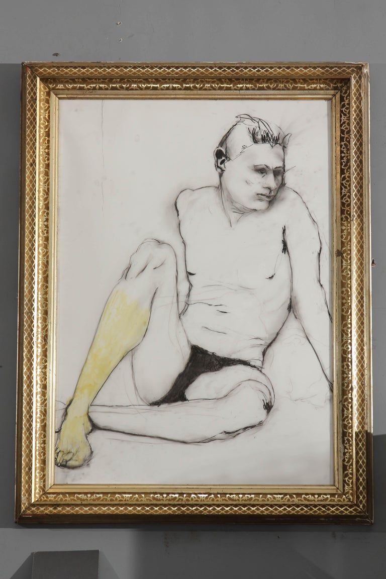 1980s black and white drawing of young man accented with a yellow leg. Framed in 19th century gilt frame.