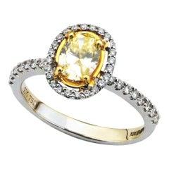 Yellow Oval 0.63 Carat Diamond White Gold Halo Engagement Ring