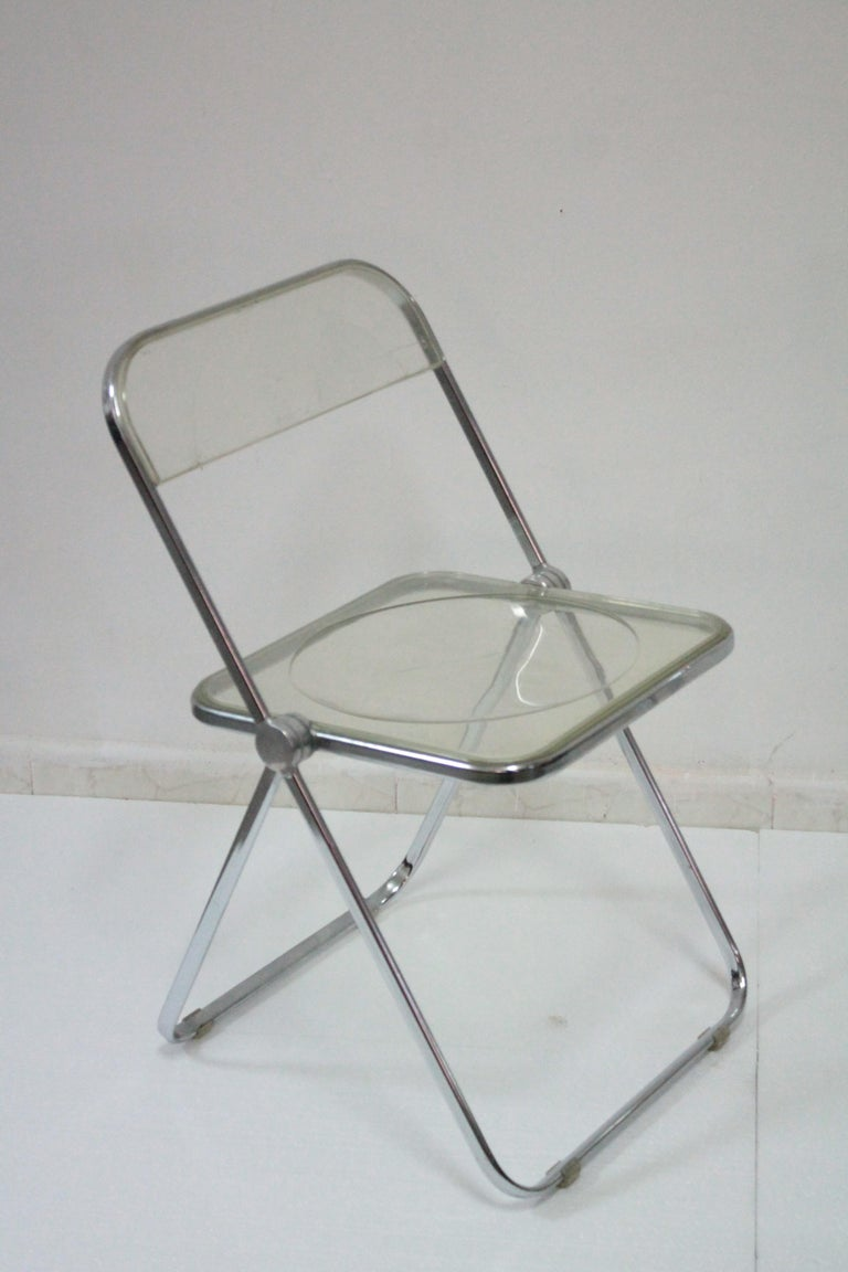 Pair of chairs by Giancarlo Piretti for Anonima Castelli, 1960s. The chairs are in very good condition but with sign of use and age. The chrome frames are in good condition with some minor flaws. The Lucite seats and backs are in good condition