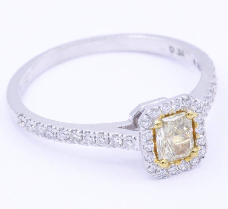 38 White Diamonds 0.23 Carats One Yellow Diamond 0.31 Carats