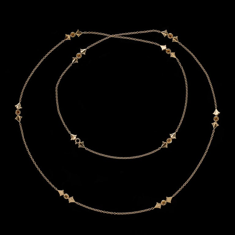 By noted Italian designer Marina B. of the famed Bulgari jewelry family, this playful and wearable necklace is designed with stations of ginko leaves centering round-cut natural yellow sapphires for 1.68 carats total weight. The necklace weighs 13.5