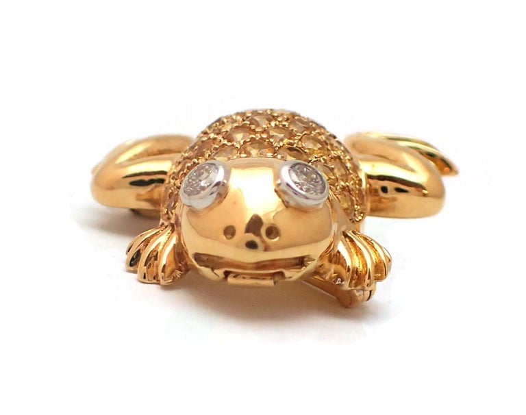 A fun and beautiful piece, this frog pin contains a body containing 1.20ct of round yellow sapphires. Additionally, two round brilliant diamonds make the eyes (0.05ct ea., G color, VS clarity). Set in 18K yellow gold, this article will enhance any