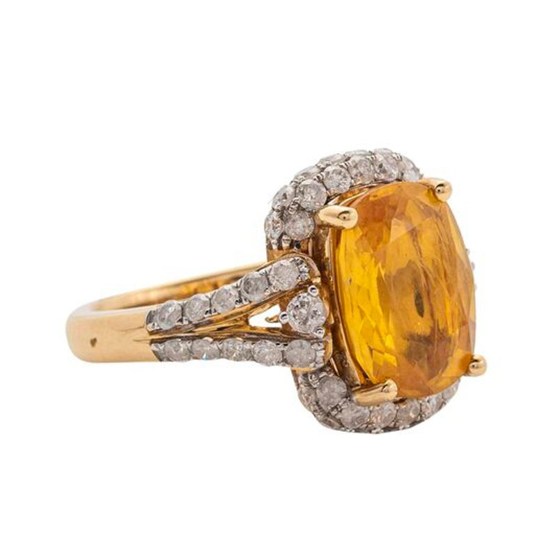 Yellow Sapphire and Diamond Ring  Yellow Sapphire weighing approximately 5.59 cts  Diamonds weighing approximately 1.21 cts  7.50 grams (gross), size 7   Accompanied with AIG paperwork stating:  14K yellow gold ladies Yellow Sapphire and Diamond