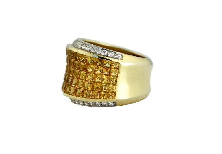 Yellow Sapphire and Diamond Ring  yellow sapphires weighing approximately 9.77 carats, mounted in 18kt white gold  10 grams (gross), size 7