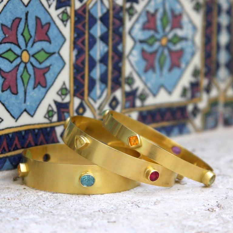Round Cut Yellow Sapphire, Blue Zircon, Pink Tourmaline, & Orange Garnet 18kt Gold Bangle  For Sale