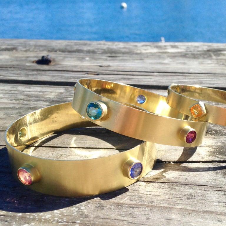 Women's or Men's Yellow Sapphire, Blue Zircon, Pink Tourmaline, & Orange Garnet 18kt Gold Bangle  For Sale