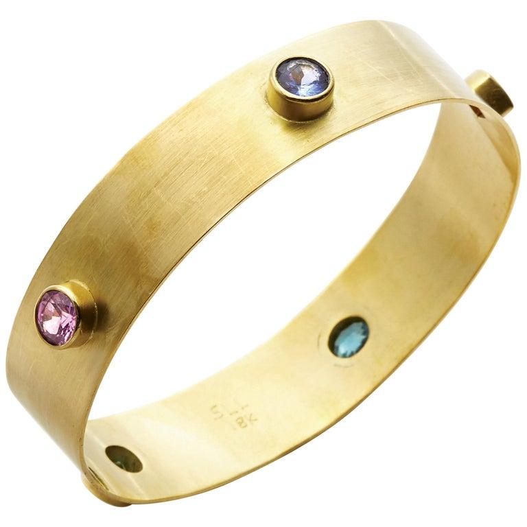 Yellow Sapphire, Blue Zircon, Pink Tourmaline, & Orange Garnet 18kt Gold Bangle  For Sale