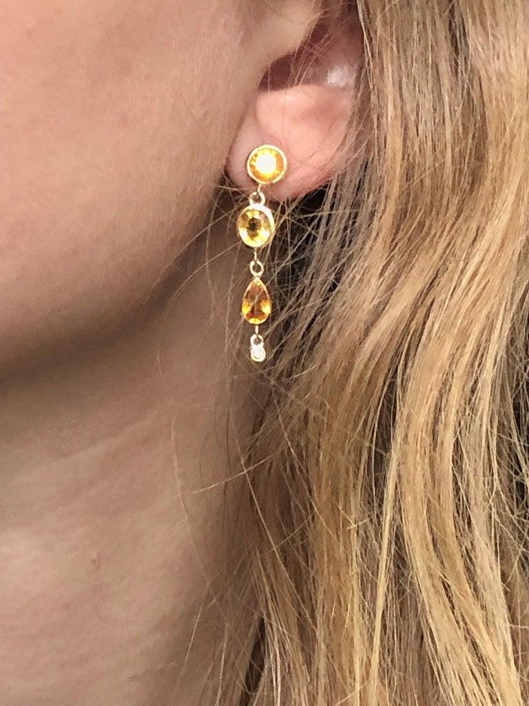 Pear Cut Yellow Sapphire Diamond Drop Earrings Weighing 6.33 Carat For Sale