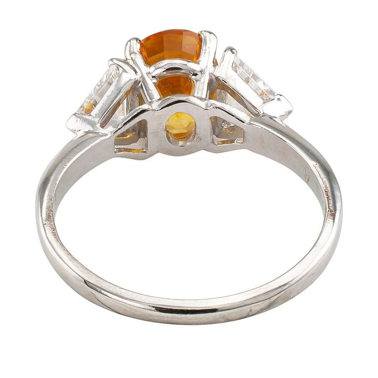 Oval Cut Yellow Sapphire Diamond Three-Stone Platinum Ring For Sale