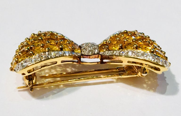 Contemporary Yellow Sapphire White Diamond 18 Karat Gold Bow Tie Brooch Pin Over 7 Carat For Sale