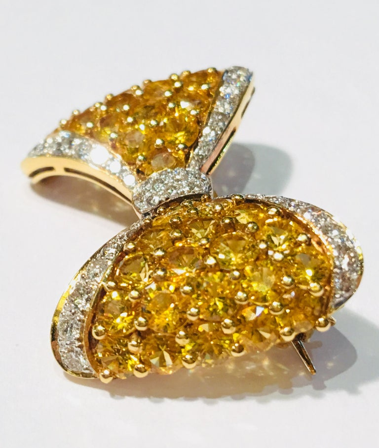 Round Cut Yellow Sapphire White Diamond 18 Karat Gold Bow Tie Brooch Pin Over 7 Carat For Sale