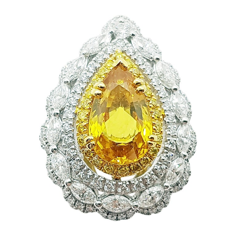 Yellow Sapphire with Diamond and Yellow Diamond Ring Set in 18 Karat White Gold For Sale