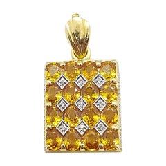Yellow Sapphire with Diamond Pendant Set in 18 Karat Gold Settings