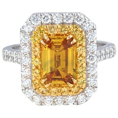 Yellow Sapphire with Diamond Ring Set in 18 Karat White Gold Settings