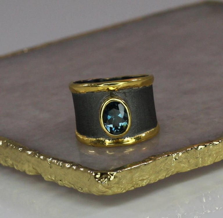 This is Yianni Creations ring from Eclyps Collection 100% handmade from fine silver 950 purity. This ring is featuring 2.50 Carat London Blue Topaz complemented by unique techniques of craftsmanship - brushed texture and nature-inspired liquid