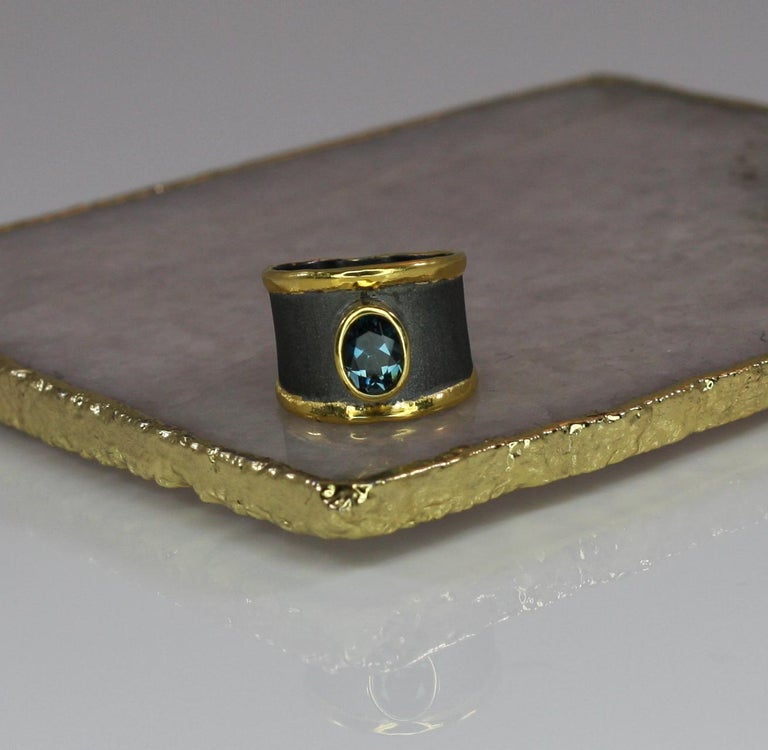 Oval Cut Yianni Creation Blue Topaz Fine Silver 24 Karat Gold Rhodium Wide Band Ring For Sale