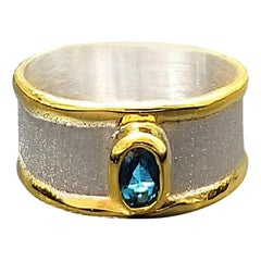 Yianni Creations 0.57 Carat Blue Topaz Ring in Fine Silver and 24 Karat Gold