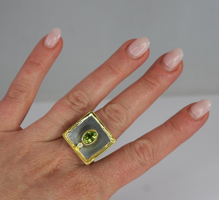 Yianni Creations presents exclusively Eclyps Collection. This square shape Artisan Ring is crafted from Fine Silver 950 purity and plated with Black Rhodium on the brushed background. The shiny liquid edges are decorated with a thick layer of 24