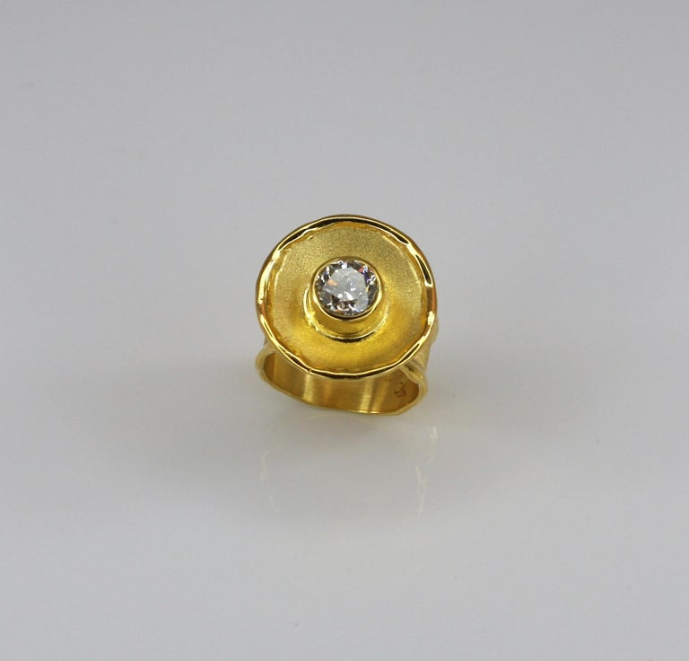 Yianni Creations presents a handmade artisan ring crafted from solid 18 Karat gold. This gorgeous ring features a 1.50 Carat brilliant cut Diamond. The unique look is created by ancient techniques of craftsmanship - Byzantine brush and melted edges.