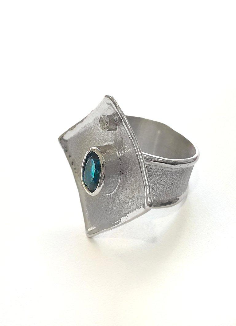 Yianni Creations Ammos Collection 100% Handmade Artisan Gorgeous Ring from Fine Silver featuring 1.60 Carat London Blue Topaz accompanied by 0.03 Carat Brilliant Cut White Diamond complemented by unique techniques of craftsmanship - brushed texture
