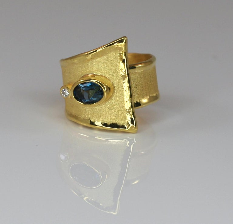 Oval Cut Yianni Creations 18 Karat Blue Topaz and Diamond Unique Adjustable Band Ring For Sale