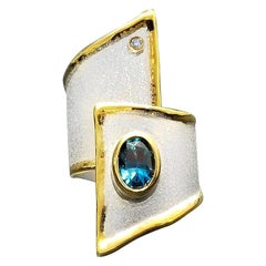 Yianni Creations 1.60 Carat Blue Topaz and Diamond Silver and Yellow Gold Ring