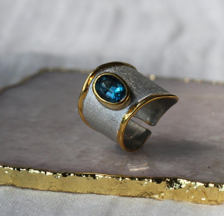 Introducing Yianni Creations Midas Collection handmade artisan ring from fine silver 950 purity plated with palladium to resist the elements. Liquid edges are decorated with an overlay of 24 Karat yellow gold contrasting with a brushed texture of
