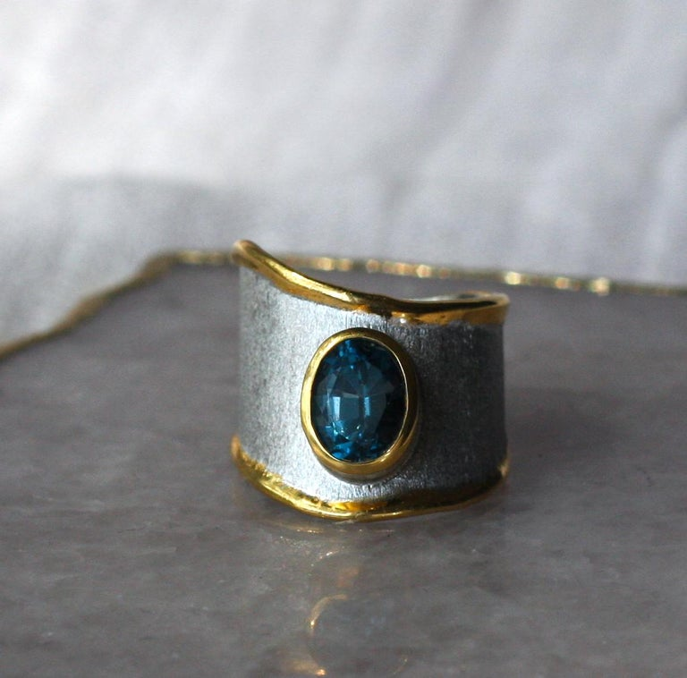 Contemporary Yianni Creations Blue Topaz Fine Silver 24 Karat Gold Adjustable Wide Band Ring For Sale