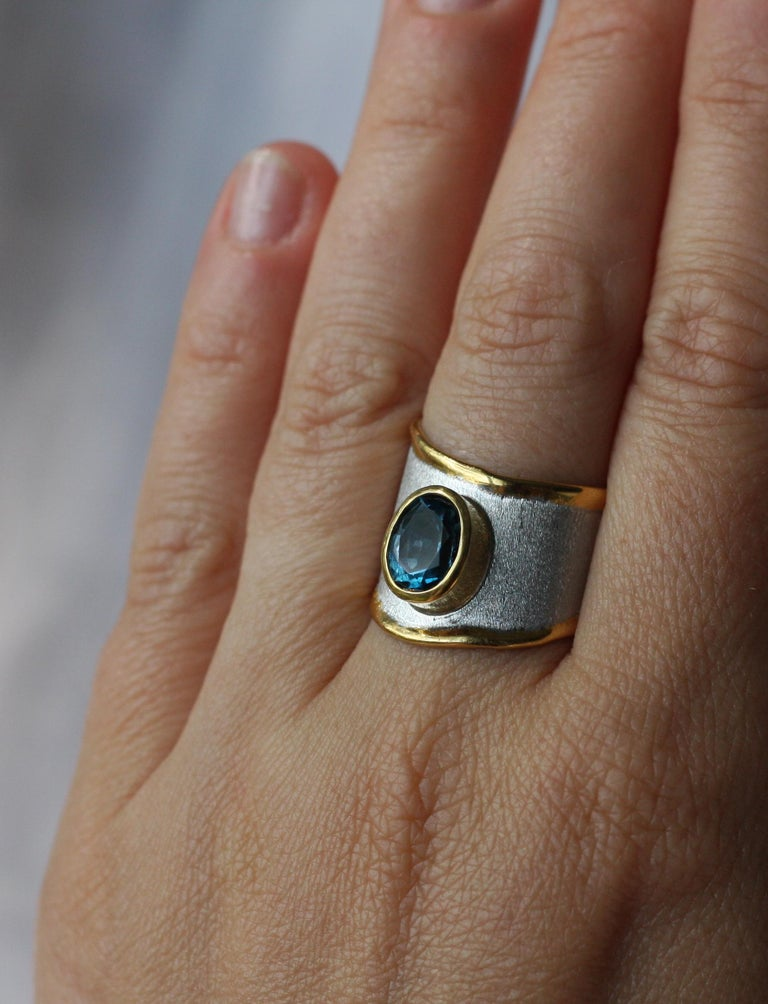 Oval Cut Yianni Creations Blue Topaz Fine Silver 24 Karat Gold Adjustable Wide Band Ring For Sale