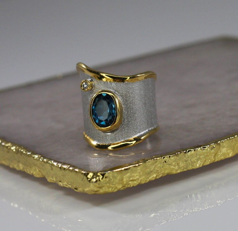 Contemporary Yianni Creations 1.60 Carat Topaz Ring with Diamond in Fine Silver and Pure Gold For Sale