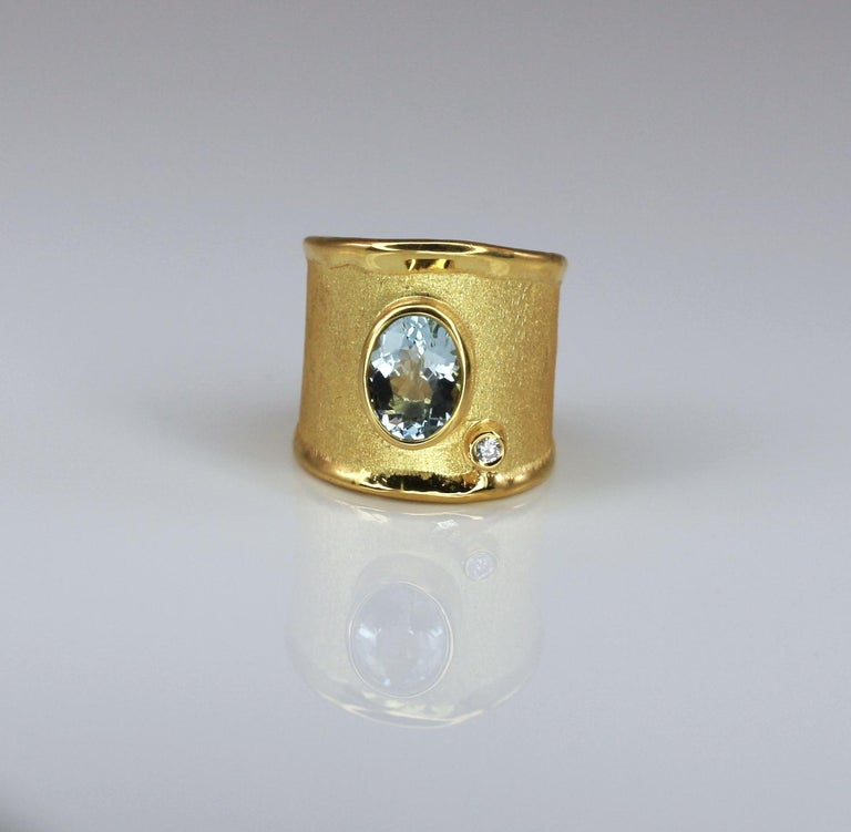 Yianni Creations artisan gorgeous ring handmade in Greece from 18 Karat Yellow Gold. We, in YC, use special techniques of craftsmanship - the brushed texture and nature-inspired liquid edges. These together make a perfect match with 1.75 Carat oval