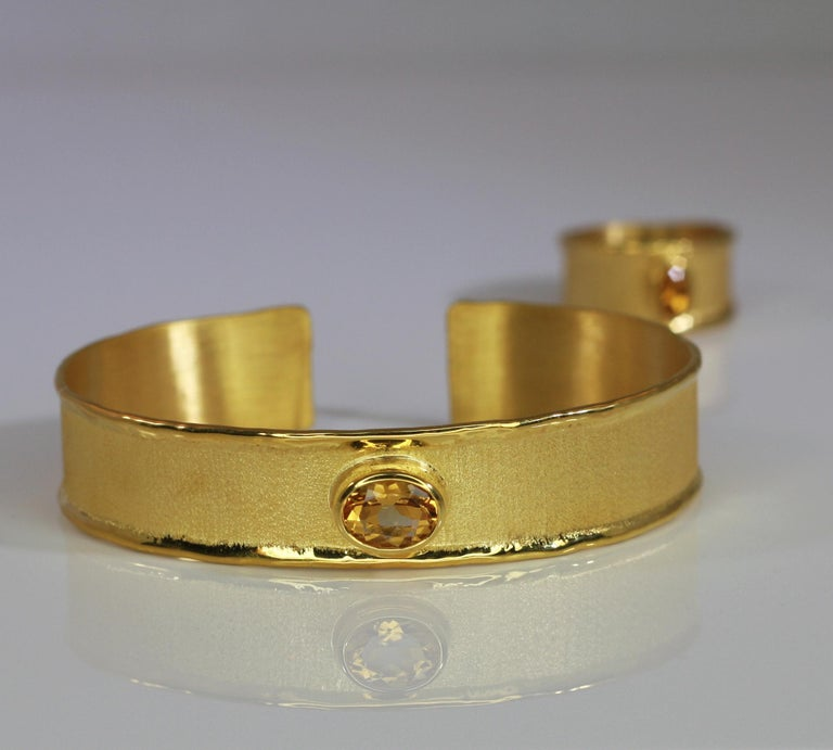 This bracelet from Yianni Creations is all handmade in Greece from 18 Karat Gold and set with 1.75 Carat Citrine. The unique look is created by using ancient techniques of craftsmanship - brushed texture and nature-inspired liquid edges.  For a full
