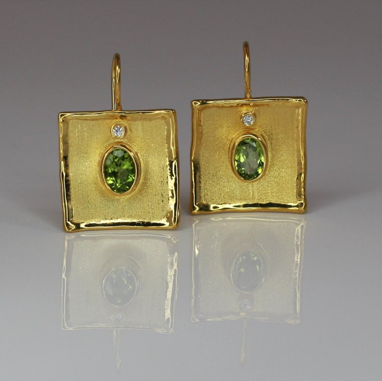 Got in love with Yianni Creations 100% Handmade Artisan Earrings crafted from 18 Karat Yellow Gold using unique techniques of craftsmanship - brushed texture and nature-inspired liquid edges. Each earring is decorated with 1.35 Carat Oval Cut
