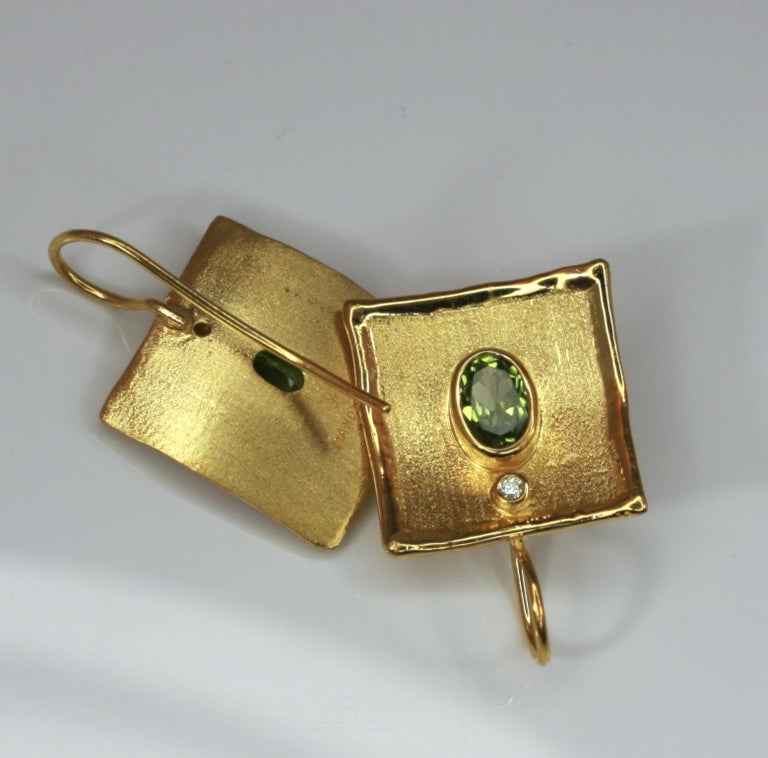 Contemporary Yianni Creations 18 Karat Gold Earrings with 2.70 Carat Peridot and Diamonds For Sale