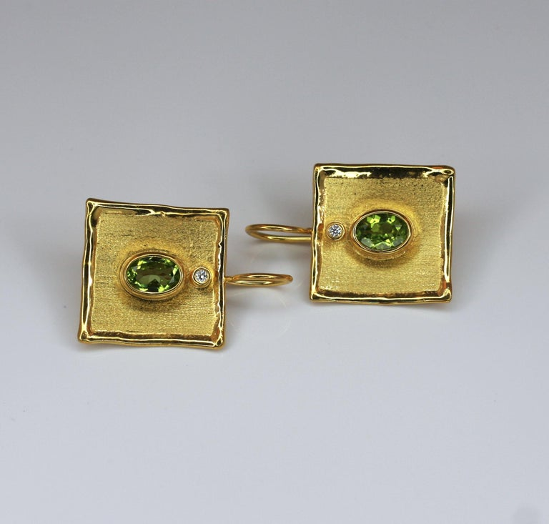 Oval Cut Yianni Creations 18 Karat Gold Earrings with 2.70 Carat Peridot and Diamonds For Sale